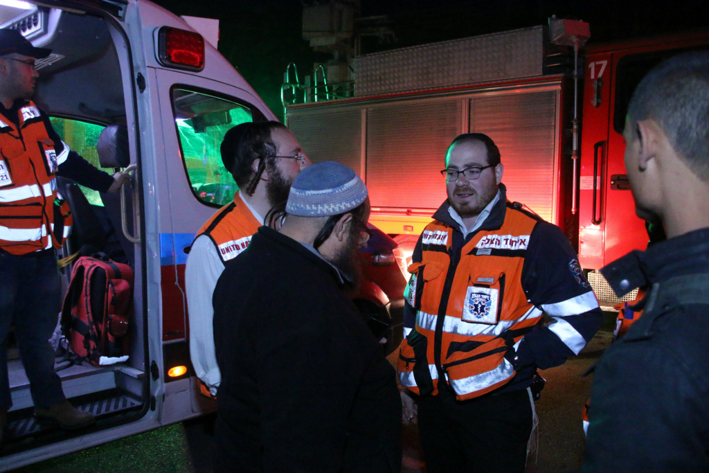 United Hatzalah EMS responders talk with Fire and Rescue responders on the night after the November fires in Haifa. Illustration - Credit: Shmulik Hershkopf - United Hatzalah