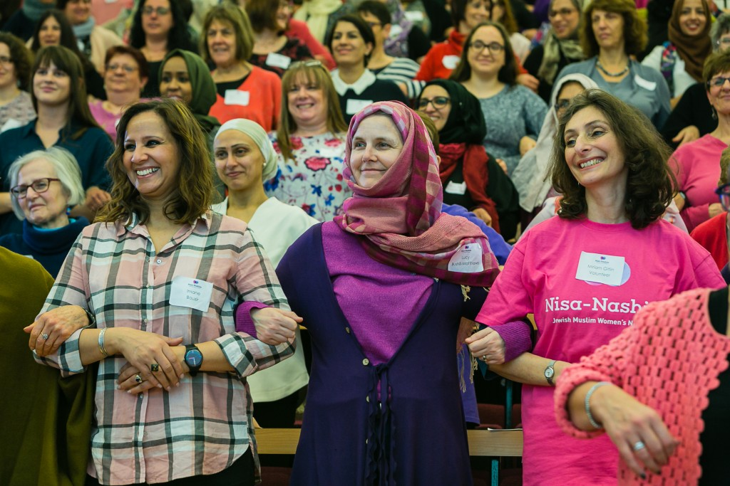 Jewish and Muslim women side-by-side in unity, during the inaugural Nisa-Nashim conference. (Photo credit: Yakir Zur)