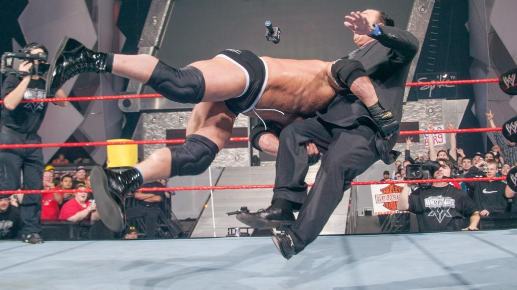 (Photo Credit: WWE.com) Paul Heyman getting speared by Goldberg