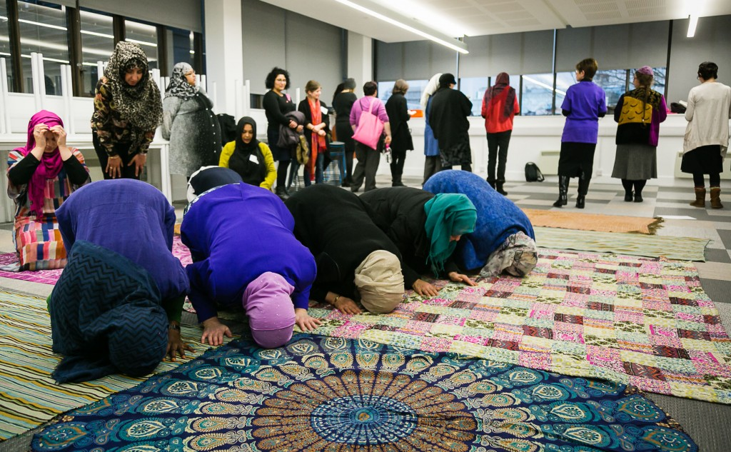 Muslim and Jewish women in prayer during the conference. Photo credit: Yakir Zur