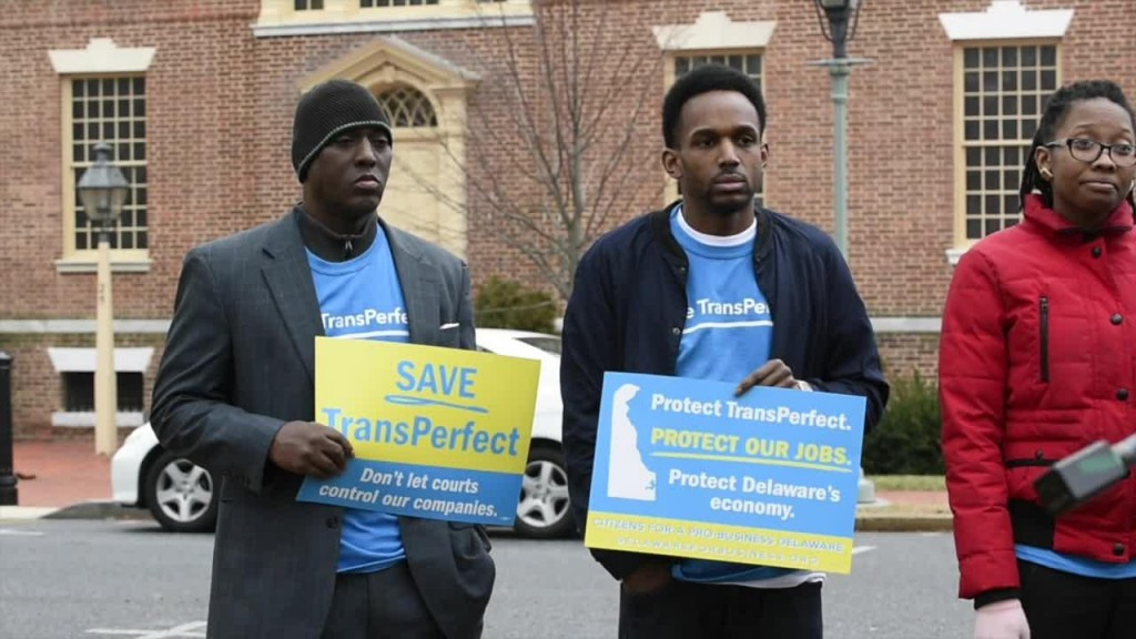 Rally in Delaware to Save TransPerfect, with 2 Supporters Holding Signs