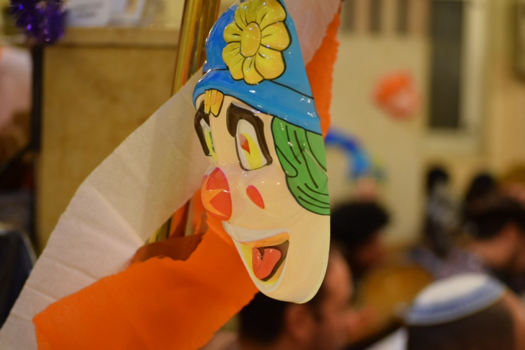 Clown masks filled the walls of the North Central Synagogue on Purim