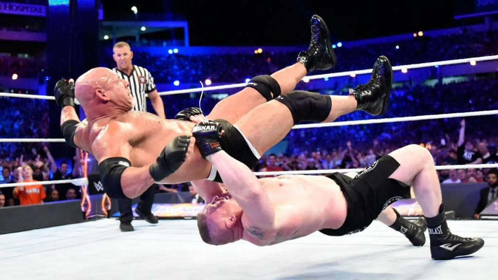 Lesnar taking Goldberg to Suplex City (Photo Credit:WWEcom)