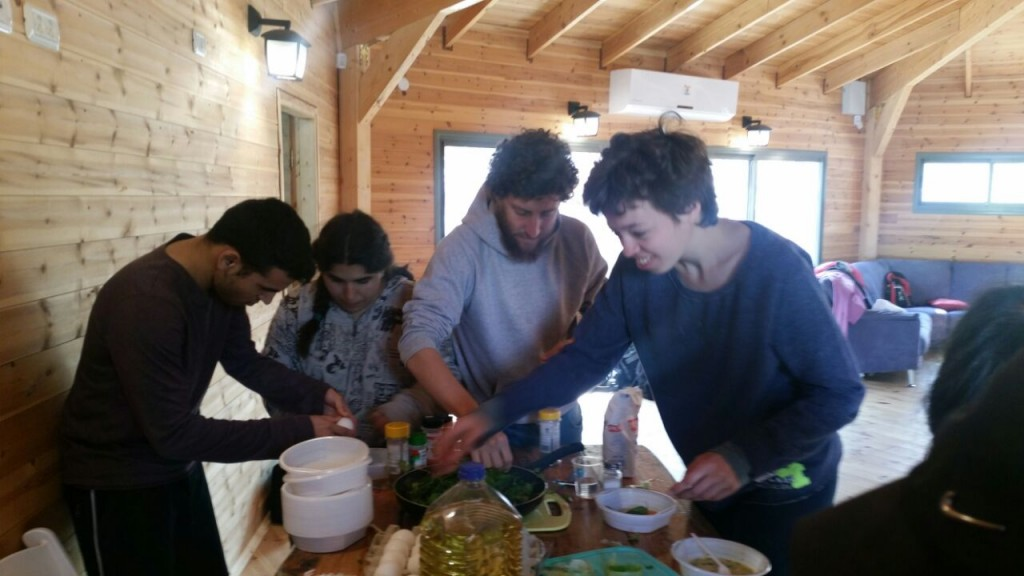Shutaf young people preparing their meal together at Passover camp 2017.