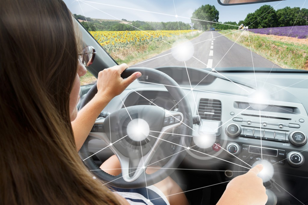 woman driving car with automatic navigation controls