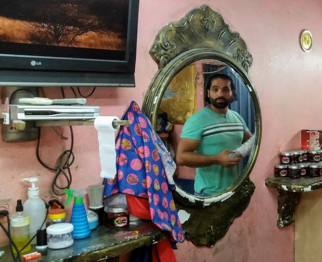 Yasser in his barber shop, May 2017