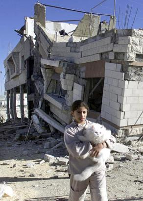 Sumayya_and_her_cat_in_front_of_her_demolished_home_2002,_2nd_Intifada