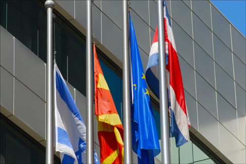 Flags of Israel, Macedonia, the European Union and Costa Rica fly in front of the Paz Towers in Ramat Gan, where the diplomatic missions of the latter three are headquartered. Photo: Larry Luxner