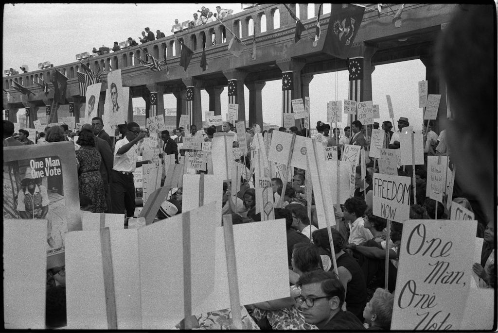 Mississippi Freedom Democratic Party supporters demonstrate for voting rights outside the 1964 Democratic National Convention in Atlantic City, N.J. Some hold signs with portraits of slain civil rights workers Andrew Goodman and Michael Schwerner. (Warren K. Leffler/Wikimedia Commons)