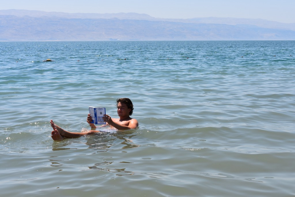 TAMID Fellow reading Startup Nation in the Dead Sea