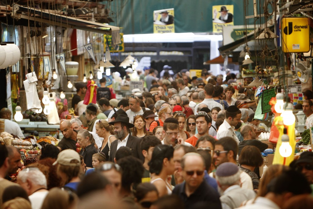 Israelis of all walks of life come together to shop for Shabbat