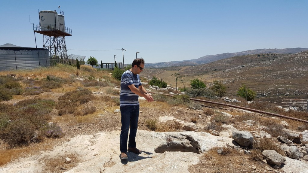 Gva'ot manager Eliav Miller shows me an ancient wine press at the winery site in Givat Har'el. (courtesy)