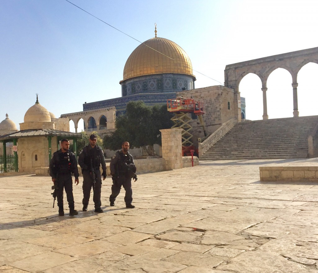 Israeli police escort Jewish visitors through the quiet Temple Mount plaza during Muslim boycott. Photo by: Judy Lash Balint