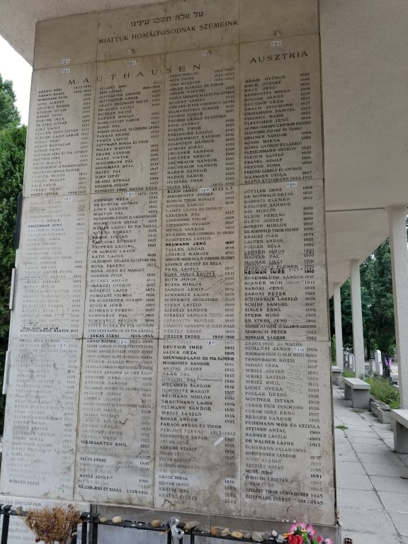 Holocaust memorial in the Hungarian Jewish Cemetery containing many names inscribed in sharpie.