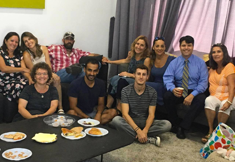"""Esteban Penrod, Costa Rica's ambassador to Israel (at right), and a few of his Costa Rican friends gather Aug. 18 in Ramat Gan for a screening of """"First Lady of the Revolution."""" Photo: Larry Luxner"""