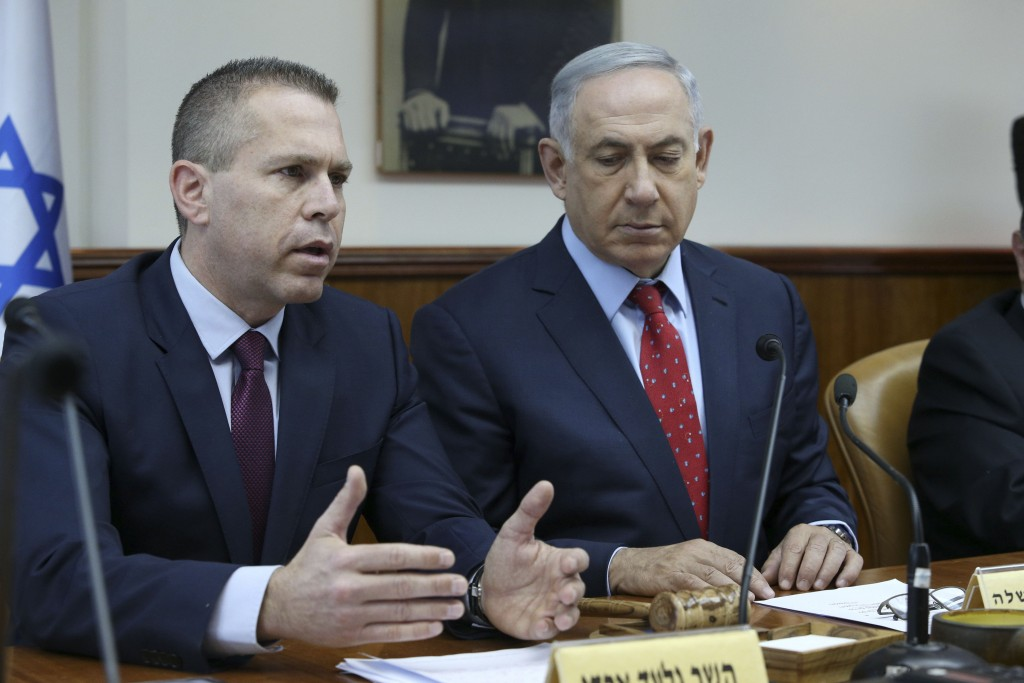 "Gilad Erdan, left, Israel's interior security minister, with Prime Minister Benjamin Netanyahu at the weekly Cabinet meeting in Jerusalem, April 10, 2016. ""No sane country would grant entry to central, pro-BDS figures who want to harm it and isolate it,"" Erdan said in March. (Amit Shabi/Pool/Flash90)"