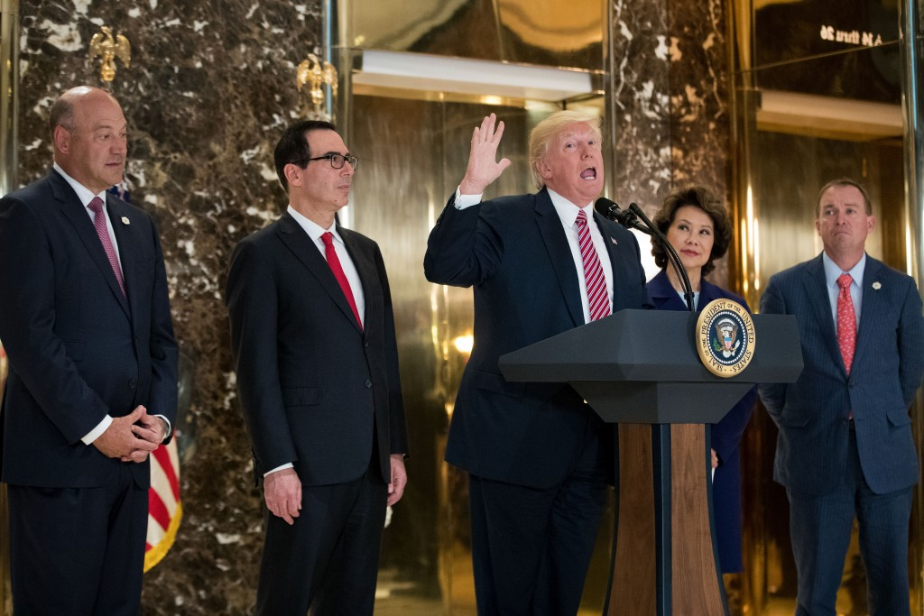 President Donald Trump speaking to the media at Trump Tower in New York City, August 15, 2017. Looking on, from left, are Gary Cohn, director of the National Economic Council; Treasury Secretary Steve Mnuchin; Transportation Secretary Elaine Chao; and Mick Mulvaney, director of the Office of Management and Budget. (Drew Angerer/Getty Images)