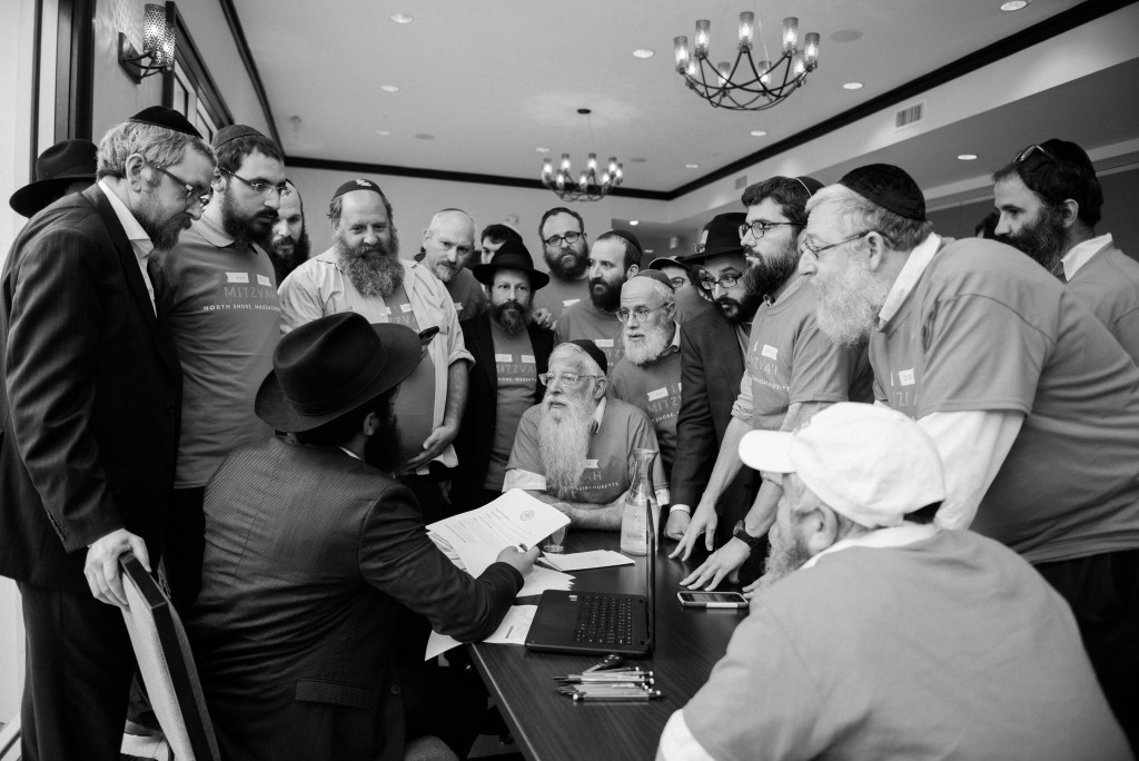 Chabad Rabbi's from across the country, gather to receive their tasks before heading out to the devastated streets of Houston.
