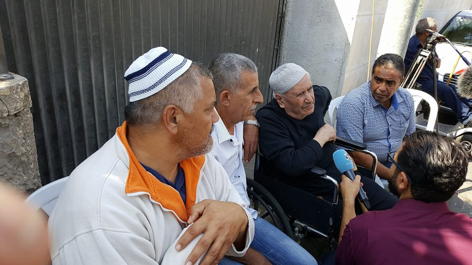 Wheelchair bound 85 year old Ayoub Shamasna outside his erstwhile home several hours after eviction.