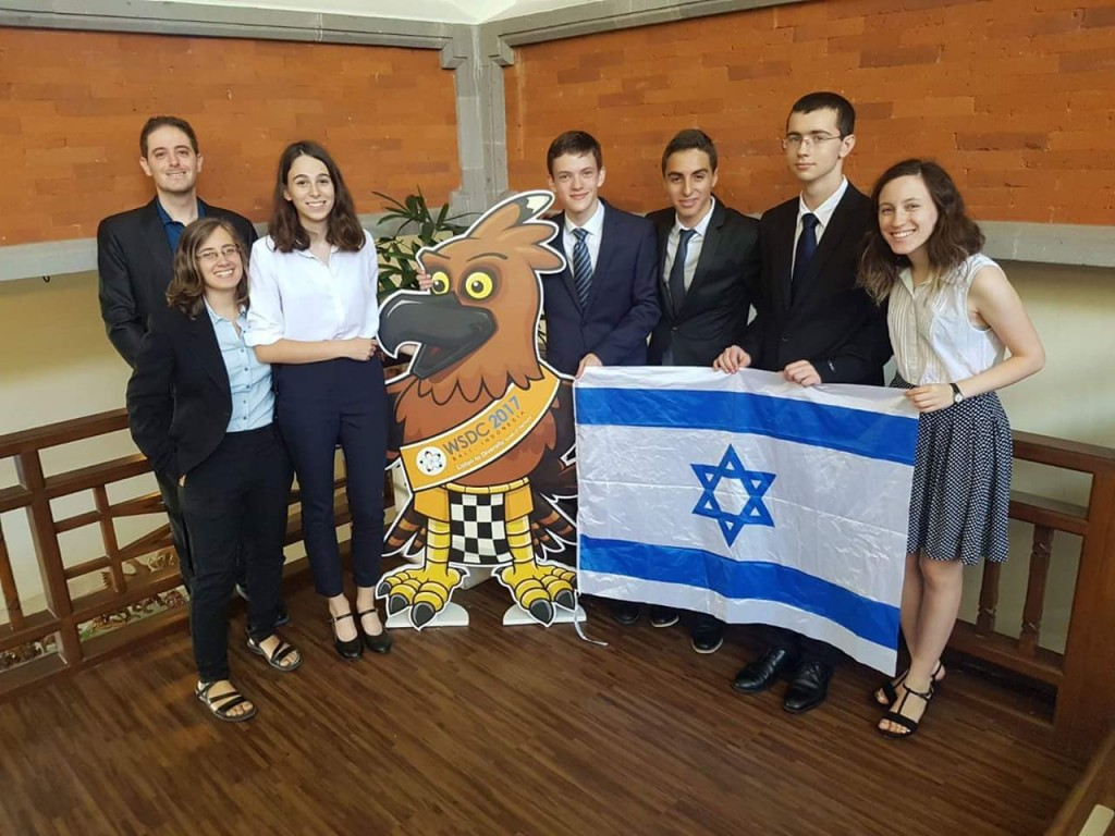 Team Israel and friend find a quiet spot to display the national flag at the 2017 World Schools Debating Championship in Bali, Indonesia
