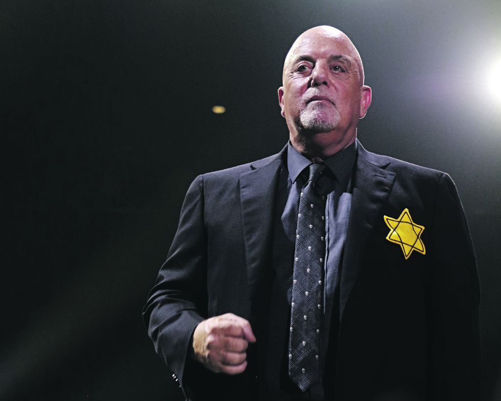 Billy Joel wearing a yellow Star of David  (Getty Images - Jewish News UK)