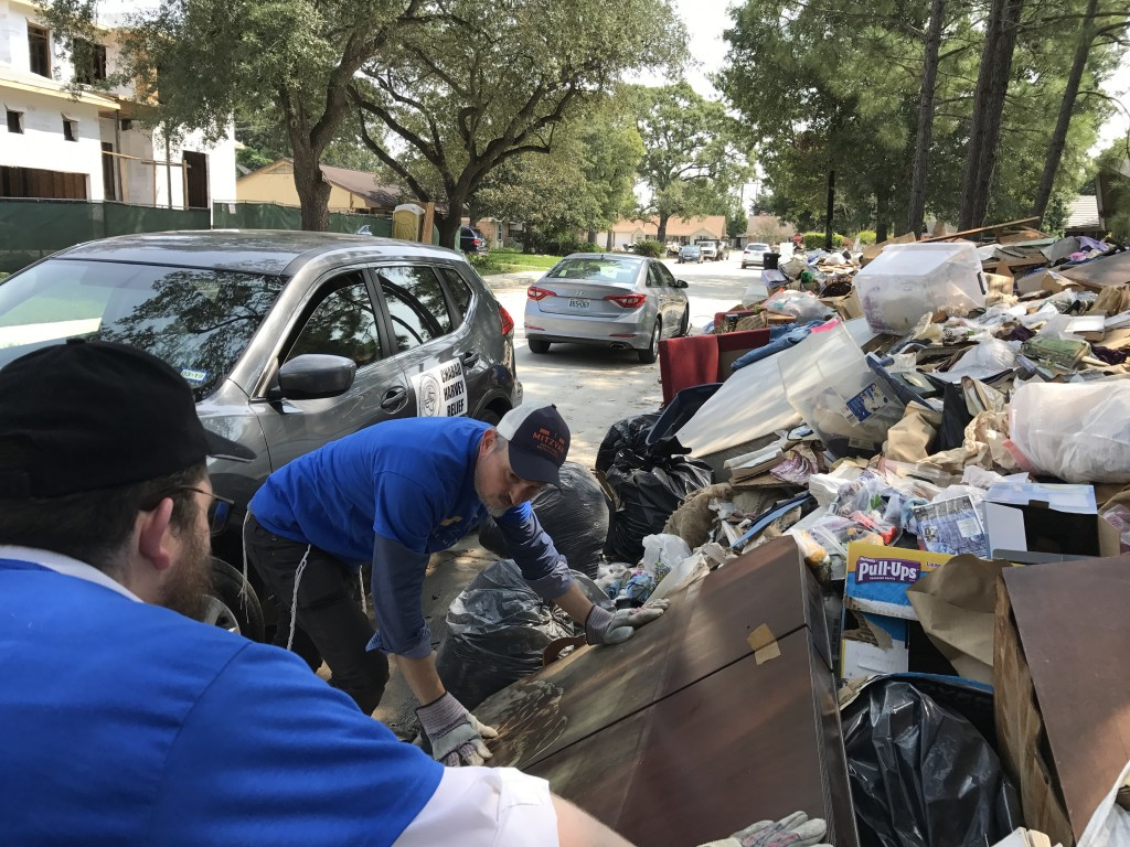 Rabbi's Yossel Kranz and Shmuli Berman, help with the clean-up.