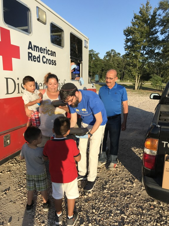 Distributing hot dinners to the residents hit hardest by Harvey
