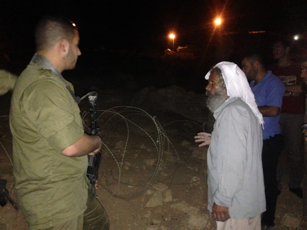 Locals talking with an Israeli soldier