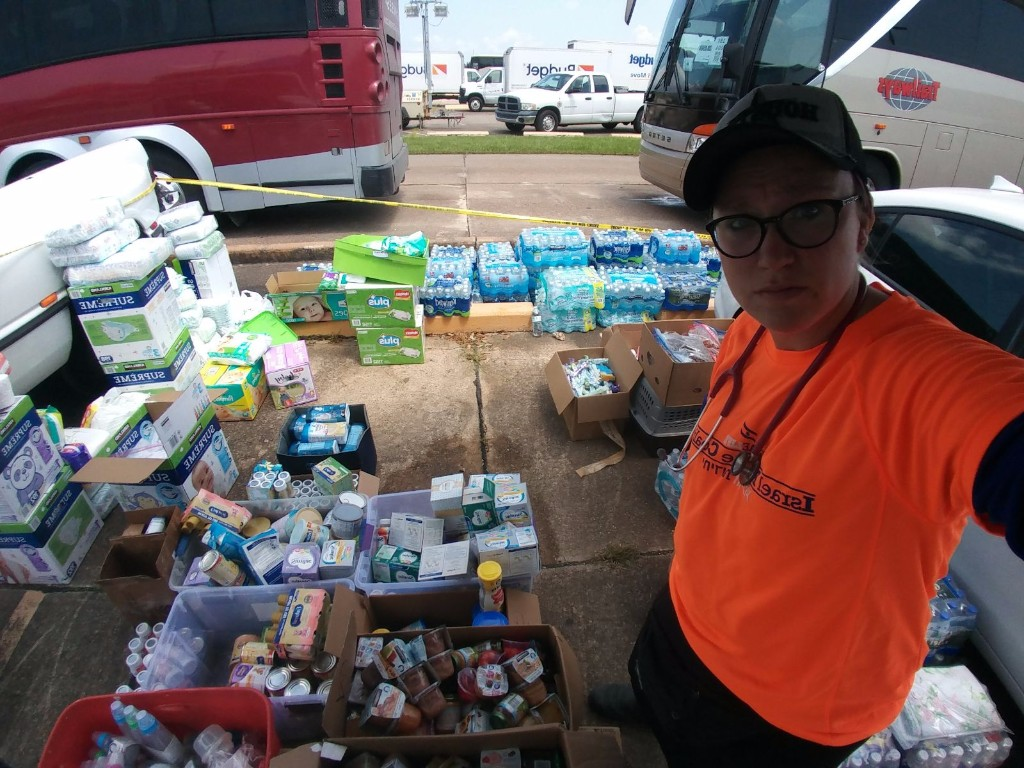 Team leader Miriam Ballin with aid items for evacuees at Jack Brooks Regional Airport in Beaumont on Friday