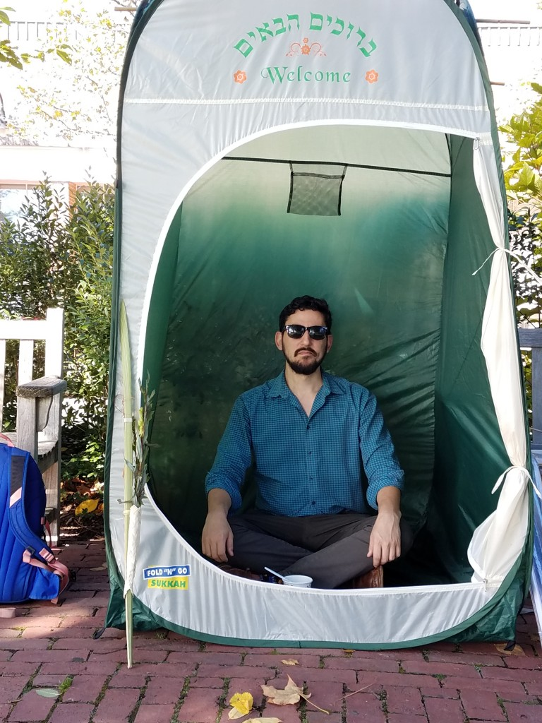 photo of Beni Summers meditating in Temple Emunah's Pop-Up Sukkah