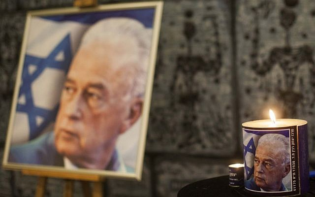 A memorial candle shines at the ceremony commemorating the 17th anniversary of former Israeli Prime Minister Yitzhak Rabin's assassination at the president's residence in Jerusalem, October 25, 2012 (Yonatan Sindel/Flash90)