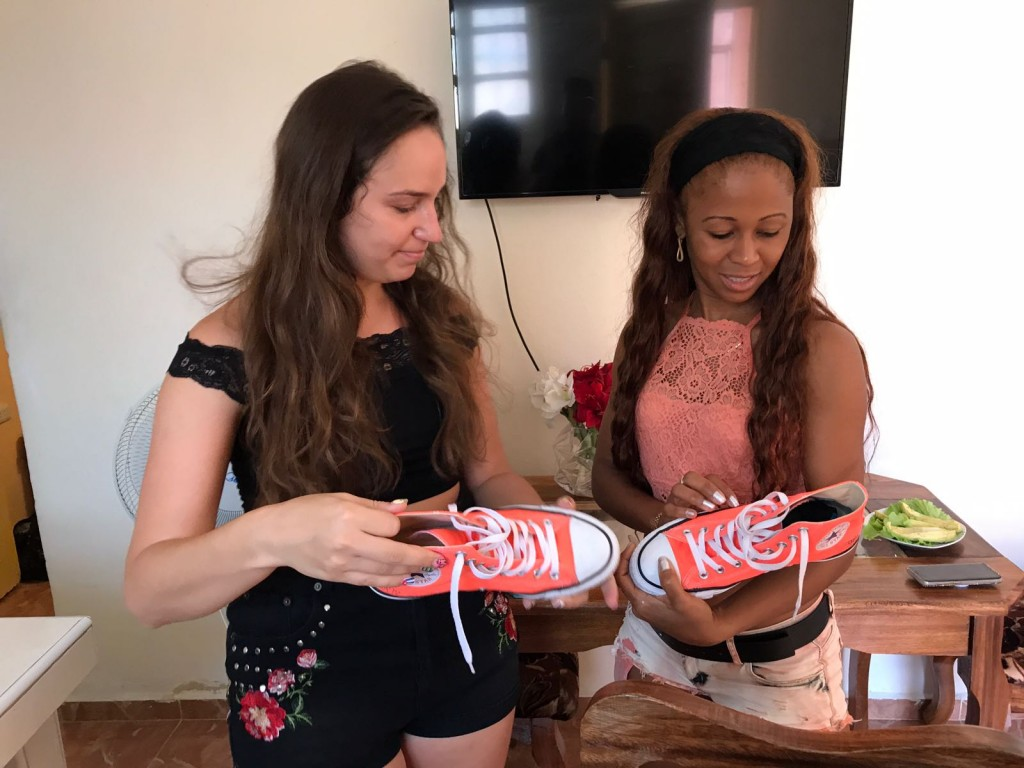 My AirBnB host Sara checking out my converse painted by artist Atomiko.