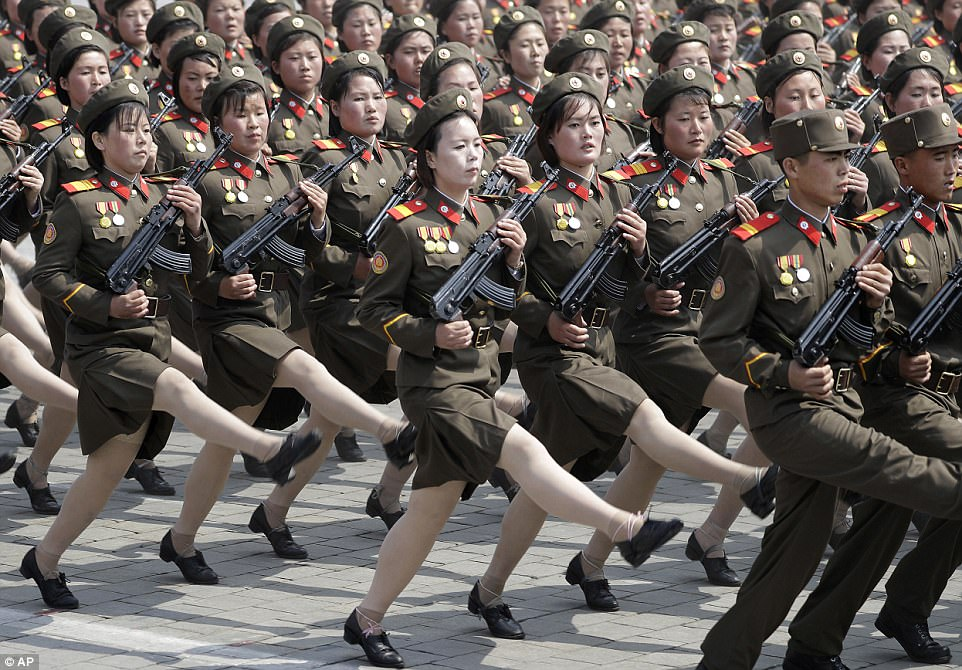 photo of Thousands of North Korean troops armed with rifles took part in the show of force, which saw North Korea flaunt sophisticated new military hardware