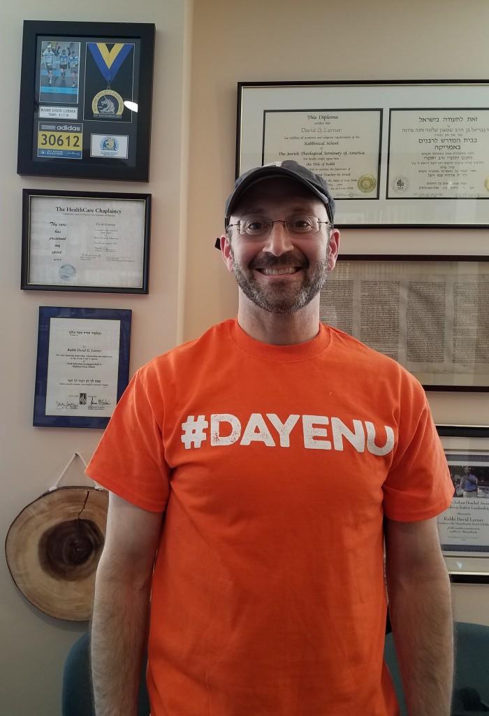 Rabbi David Lerner of Temple Emunah in Lexington wearing orange #Dayenu t-shirt