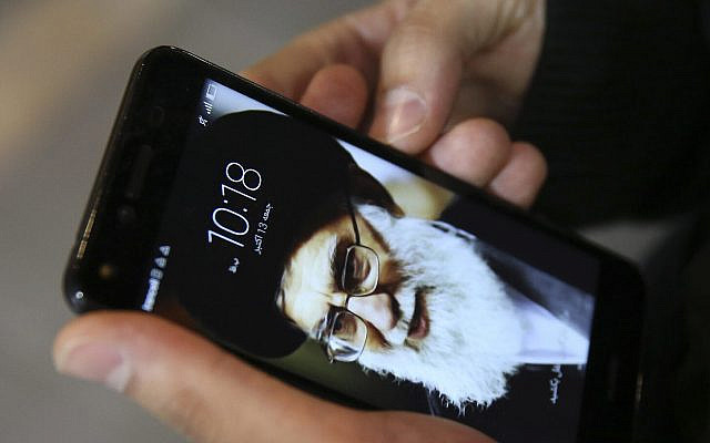 "A Tehran resident, Hamed Ghassemi, works on his cell phone, with a portrait of Iranian Supreme Leader Ayatollah Ali Khamenei, after speaking in an interview with The Associated Press in a reaction to U.S. President Donald Trump's announcement of Iran nuclear deal, in central Tehran, Iran, Friday, Oct. 13, 2017. ""Iran has in no way violated the nuclear deal, and as far as we know it has always remained committed to its promises, but it has always been them (Americans) who have broken their promises and have had other options on the table,"" said Hamed Ghassemi. (AP Photo/Vahid Salemi)"