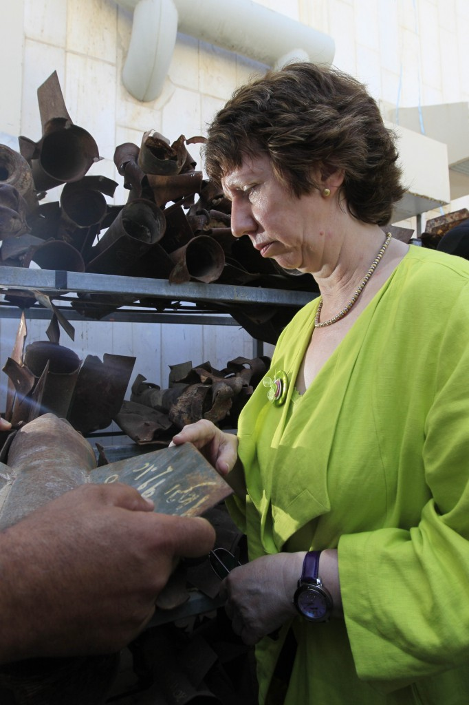 Catherine Ashton examines the remains of a Kassam rocket during a visit to Sderot in 2010. (photo credit: Tsafrir Abayov/Flash90)