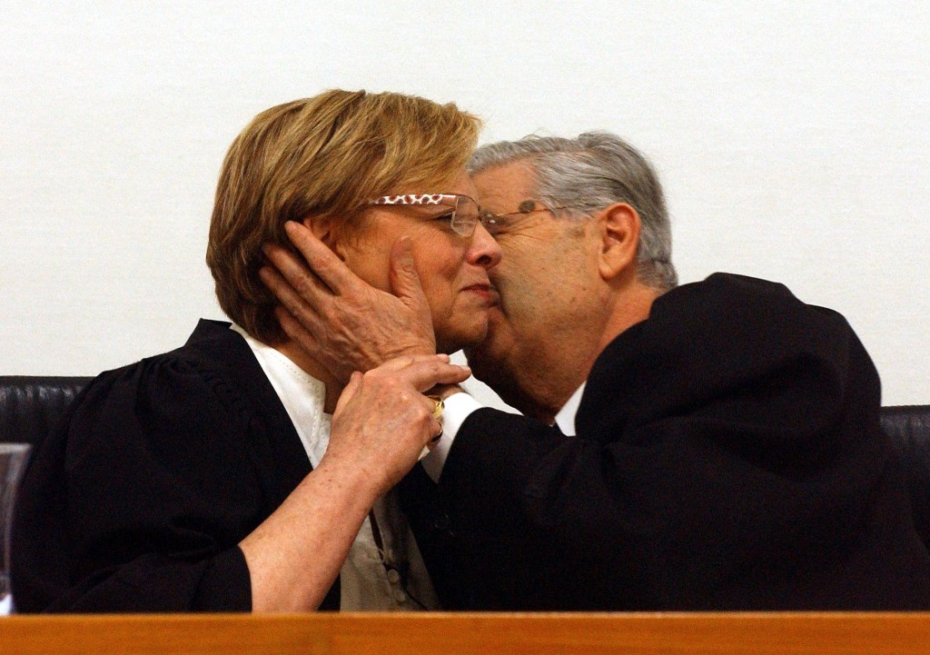 The passing of the left-wing ultra-secularist torch? Aharon Barak kisses his successor Dorit Beinisch at his farewell ceremony from the Supreme Court in 2006 (photo credit:Yossi Zamir/Flash90)