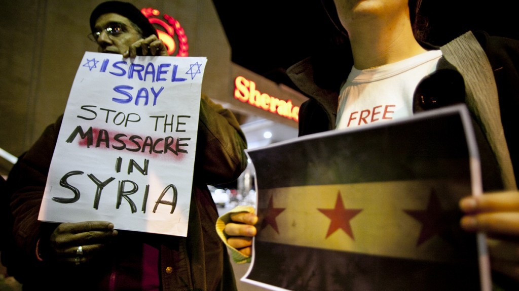 Israeli activists hold a candlelight vigil outside the Russian embassy in Tel Aviv to protest Moscow's defense of the Assad regime. (photo credit: Dima Vazinovich/Flash90)