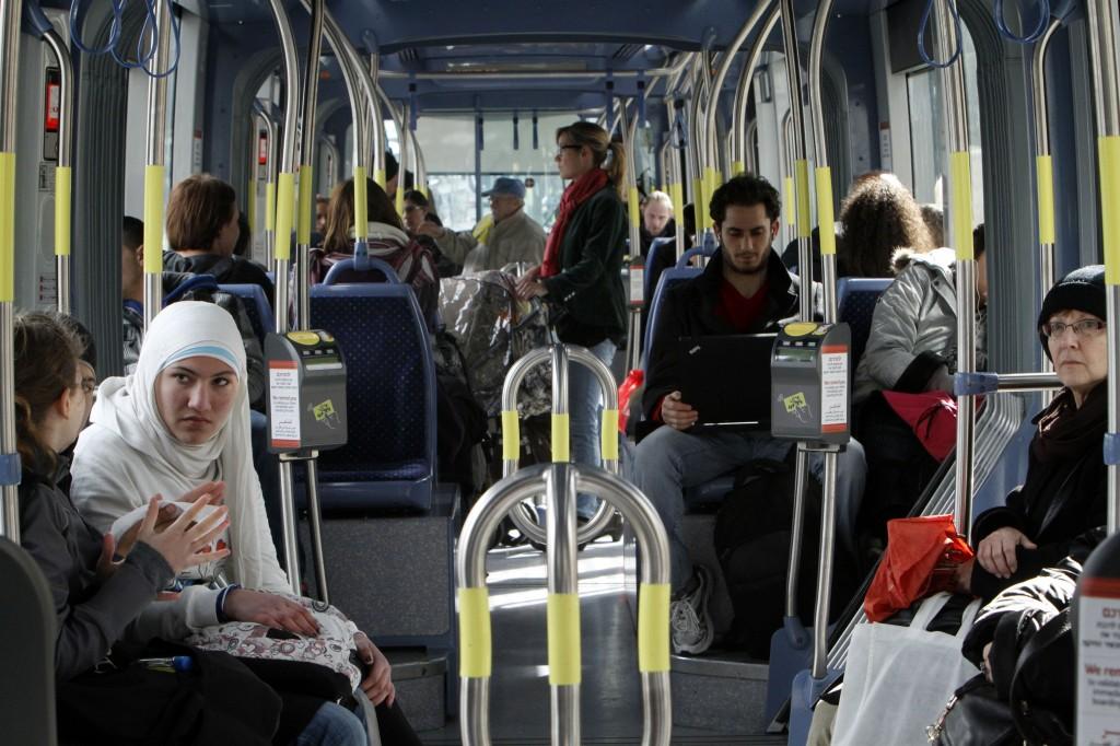 Jews and Arabs riding the Jerusalem Light Train (photo credit: Miriam Alster/Flash 90)