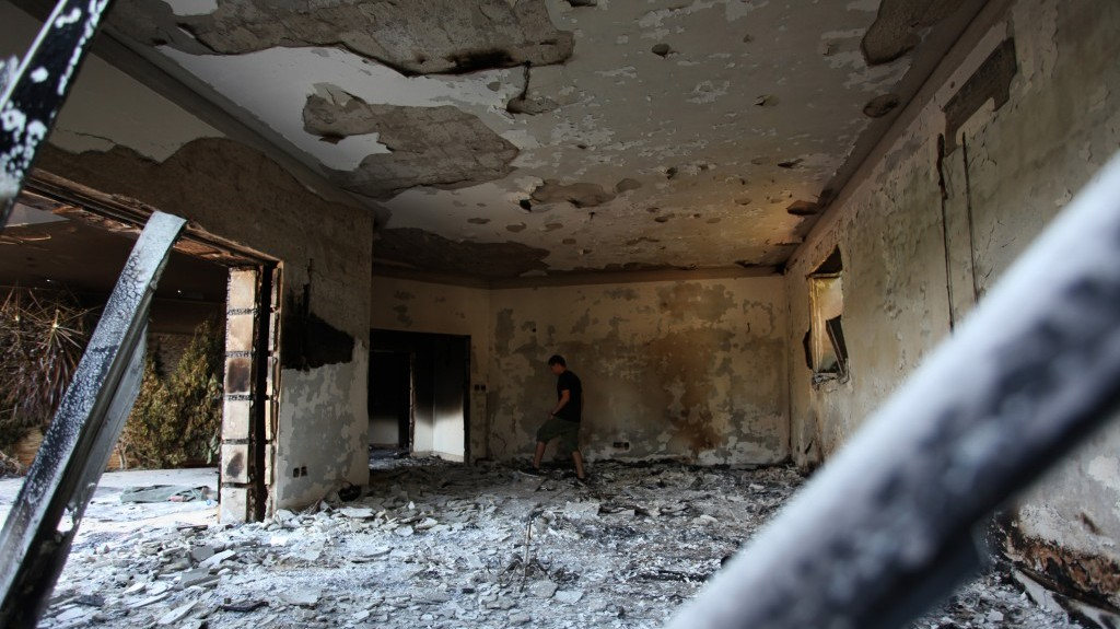 A Libyan man walks through the rubble of the damaged US Consulate in Benghazi after an attack that killed four Americans, including Ambassador Chris Stevens, on the night of Tuesday, September 11, 2012 (photo credit: AP/Mohammad Hannon)