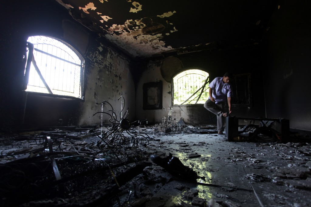 A Libyan man investigates the inside of the US Consulate, after an attack that killed four Americans, including Ambassador Chris Stevens, on the night of Tuesday, Sept. 11, 2012, in Benghazi, Libya (photo credit: AP/Mohammad Hannon)