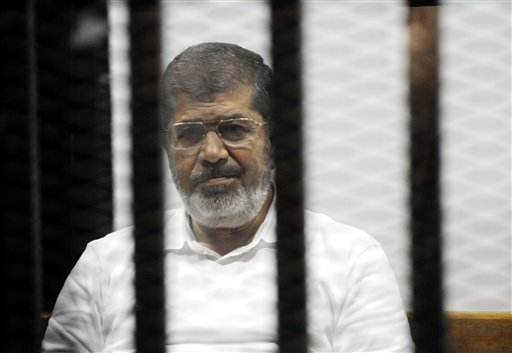 Mohammed Morsi in a cage