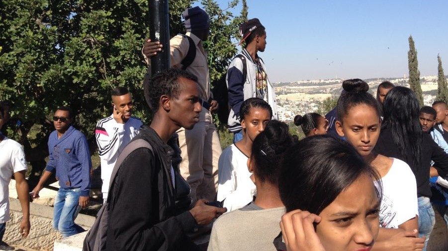 Ethiopian-Israeli teens hanging out on the Tayelet (photo credit: Jessica Steinberg/Times of Israel)