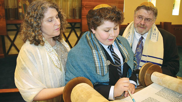 Jeremy Shinder with his mother and father preparing for his bar mitzvah.