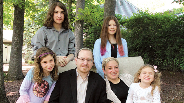 Rabbi Ely Allen with his family, clockwise from bottom left, Orah, Abraham, Sara, and Neima, and his wife, Rebecca.
