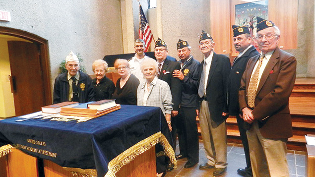 Back row, from left, West Point chaplain Rabbi Major Henry Soussan, Leonard Cohen, Sol Moglen, Post Commander Edwin Glasspool, Michal Chiaet, and Bernard Gorovitz. Front row, from left, Henry Wolff, Claire Wolff, Maxine Berger, and Holocaust survivor Rickie Bernstein.