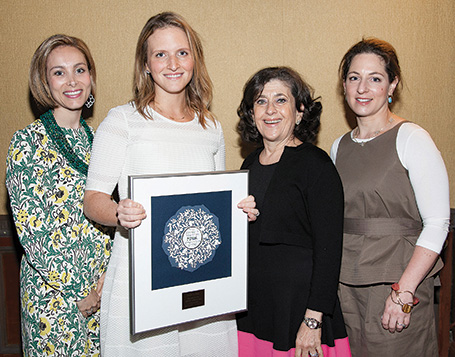 Luncheon co-chairs Sora Grunstein, left, and Tova Gerson, right, flank honoree Dr. Micole Tuchman of Englewood and Emunah's national president, Karen Spitalnick of Great Neck.