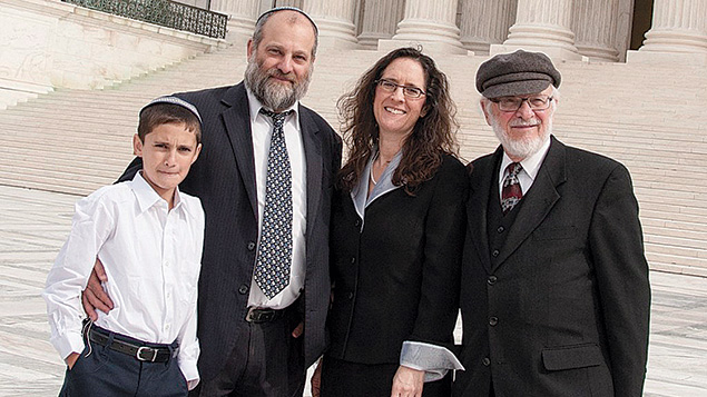 Menachem Zivotofsky, left, and his father, Ari, stand in front of the Supreme Court with their attorney, Alyza Lewin, and Lewin's father, Nathan, last November.
