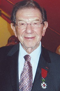 Albert Burstein beams in 2010, wearing a newly awarded medal from the government of France.