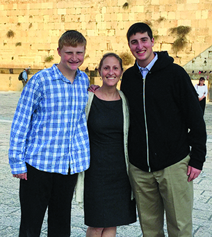 Ms. Shoretz with sons Dovid, left, and Shlomo at the Kotel last December.